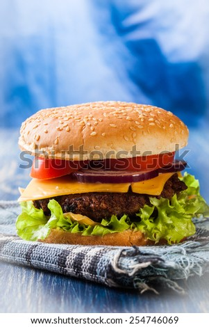 Hamburger on paper and blue table