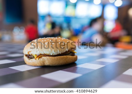 Hamburger on table in Fastfood shop - stock photo