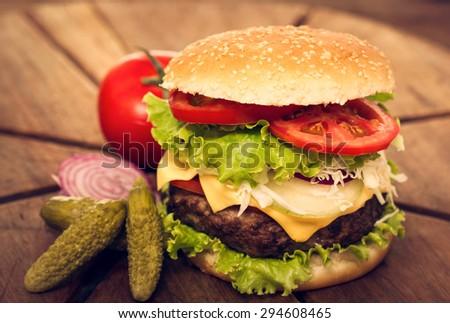 Hamburger on the table closeup - stock photo