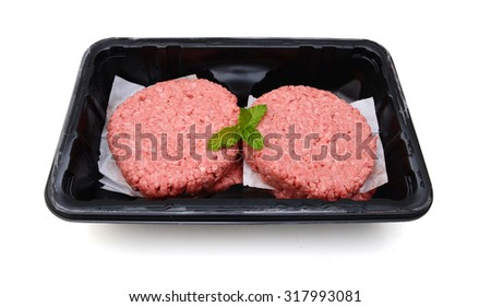 Hamburger patties isolated in tray on white background - stock photo