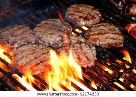 Hamburger patties on the grill - stock photo