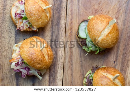 Hamburger sliders with Shrimp on a rustic cutting wooden board - stock photo