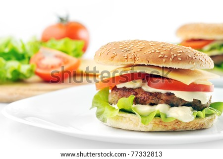 hamburger with cutlet and vegetables on dish - stock photo