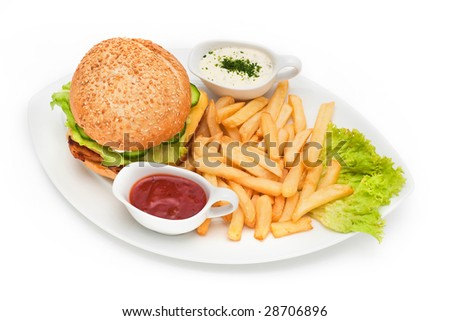 Hamburger with fries and sauces on plate - stock photo