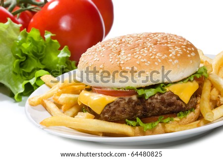 hamburger with fries and vegetables on white background - stock photo