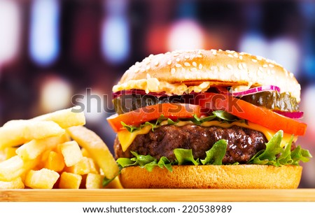 hamburger with fries on wooden table - stock photo