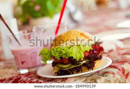 hamburger with lettuce leaves - stock photo