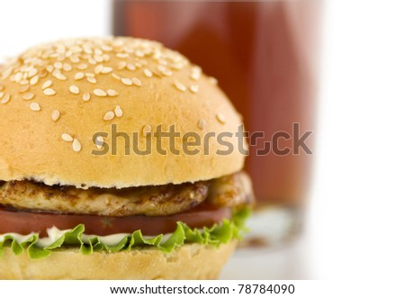 hamburger with  meat of bird and glass of drink on a white background
