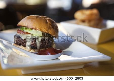 Hamburger with Onion Rings - stock photo