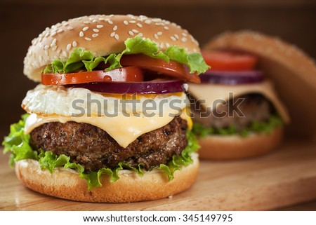 hamburger with pork grilled,egg fried and vegetable - stock photo