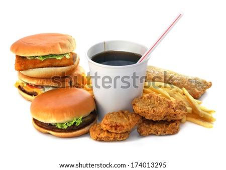 Hamburgers fried potatoes and drink - stock photo