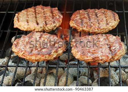 hamburgers on the grill - stock photo