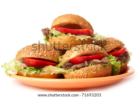 hamburgers with vegetables on a orange plate - stock photo
