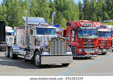 HAMEENLINNA, FINLAND - JULY 11, 2015: Classic Kenworth and Finnish cab over show trucks at Tawastia Truck Weekend 2015.