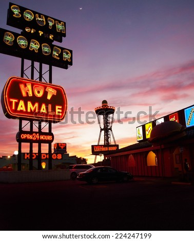 HAMER, SOUTH CAROLINA -  FEBRUARY 25, 2012: South Of The Border, a popular tourist stop for travelers just over the North Carolina/South Carolina line, glows with kitschy neon signs at after sunset.  - stock photo
