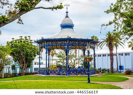 HAMILTON,BERMUDA, MAY 25 - Children play wearing school uniforms by the old gazebo in Victoria Park on May 25 2016 in Hamilton,Bermuda. - stock photo