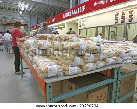 HAMILTON, CANADA - JULY 4, 2014: Food corridor in Costco Wholesale store  Hamilton Ontario, Canada.  Costco operates a chain of membership warehouses, carrying merchandise at lower prices.  - stock photo