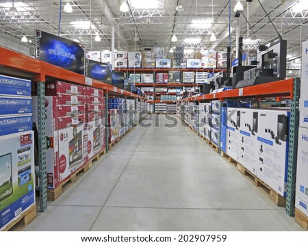 HAMILTON, CANADA - JULY 4, 2014: Television corridor in Costco Wholesale store  Hamilton Ontario, Canada.  Costco operates a chain of membership warehouses, carrying merchandise at lower prices.  - stock photo