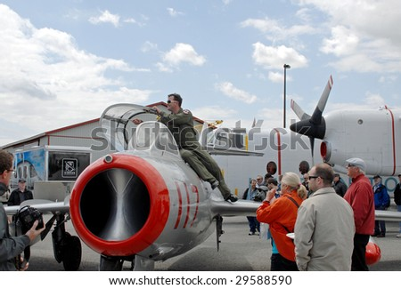 HAMILTON, ON - MAY 2 : Crowd looks at a MIG jet  on display at the 17th Canadian Aviation Expo, May 2 2009 in Hamilton, Ontario