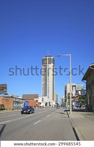 HAMILTON, ONTARIO - JULY 20, 2015: Main Street, Hamilton. Hamilton is the centre of a densely populated and industrialized region at the west end of Lake Ontario  - stock photo