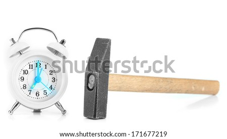 Hammer and alarm clock isolated on white - stock photo