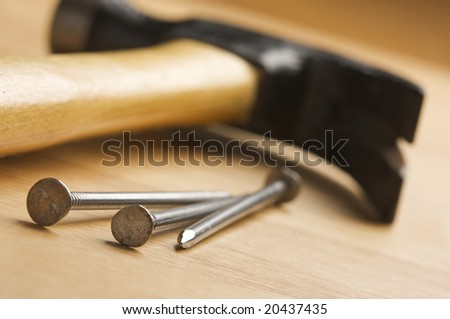 Hammer and Nails Abstract on Wood Background. - stock photo