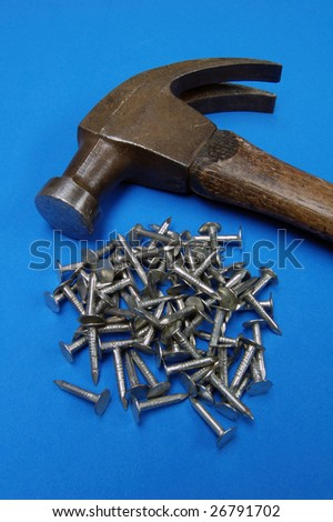 Hammer and nails on blue background