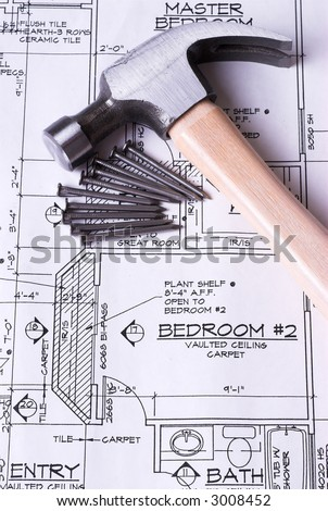 Hammer and Nails on Blueprints - stock photo