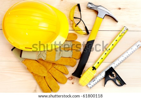 Hammer and ruler over wood plank.  Renovation - stock photo