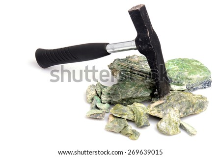 Hammer and serpentynite isolated on white background - stock photo
