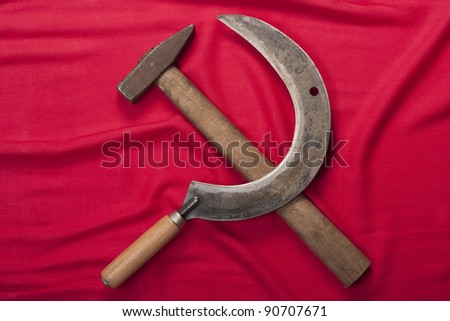 Hammer and sickle on a red flag background. - stock photo