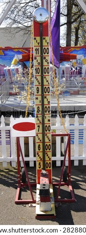Hammer contest a country fair. With bell atop. - stock photo