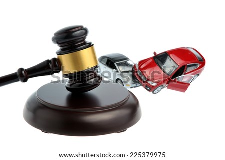Hammer of judge with models of car accident isolated on white background - stock photo