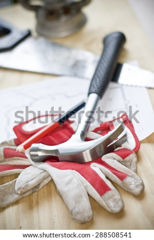 Hammer on a carpenter's work station - stock photo