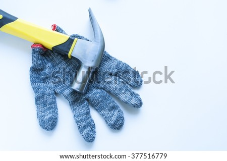 Hammer on Glove on white background - stock photo