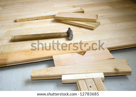 Hammer on wooden to a floor