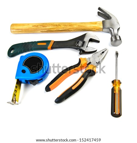 Hammer,  pliers, wrench, screwdriver and tape measure isolated over white background - stock photo