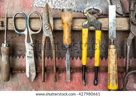 Hammer, screwdriver, wrench, chisel, tape measure and other  construction tools. Vintage set of hand tools on a wooden background - stock photo