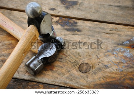 Hammer set of hand tools or basic tools on wooden background.