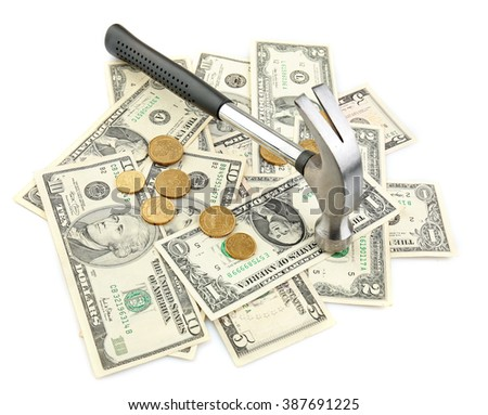 Hammer with dollar banknotes and coins, isolated on white. Repair costs concept - stock photo