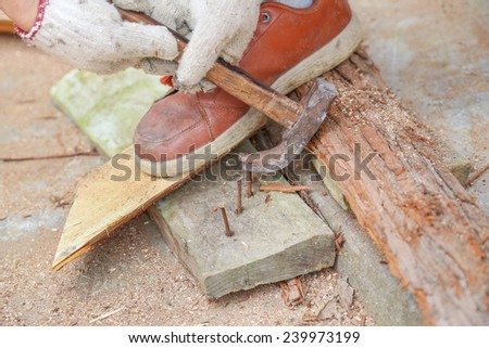 hammer with nail - stock photo