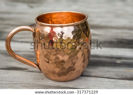 Hammered Copper Coffee Mug - stock photo
