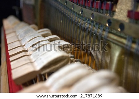 hammers of a Steinway grand piano forming a chord   - stock photo