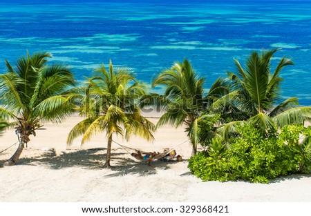 Hammock at tropical beaches on paradise island - stock photo