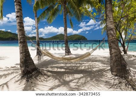 Hammock on a beautiful tropical beach.  - stock photo