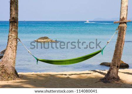Hammock on a tropical beach - stock photo