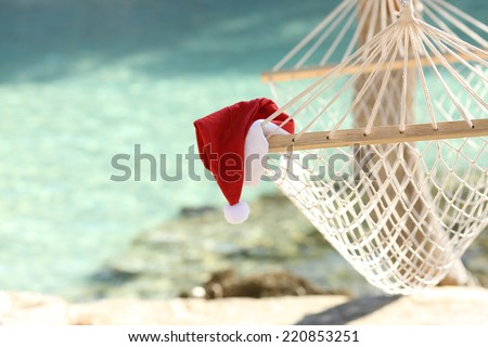 Hammock on a tropical beach resort in christmas holidays with the sea water in the background - stock photo