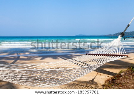 hammock on the beach - stock photo
