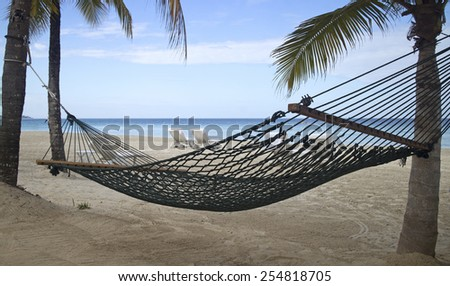 hammock on the beach - stock photo