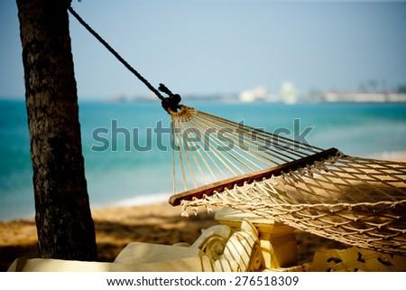 hammock relaxation on beach and ocean - stock photo
